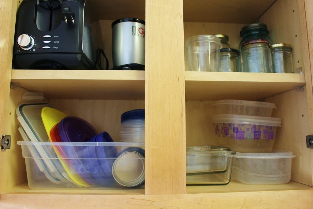 Remember those plastic boxes? Use them as a place to keep all those unruly container lids!